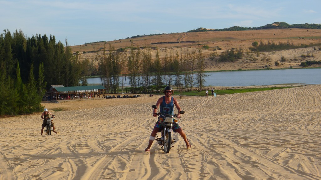 Having some fun on the sand dunes of Mui Ne